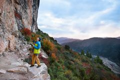 Outdoor sport activity. Rock climber.Travel destination, Spain,. Outdoor sport activity. Rock climber choosing a sport climbing route a challenging cliff. Travel Royalty Free Stock Photo