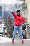 Woman wearing sportswear exercising outside during winter Stock Images