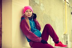 Woman wearing warm sportswear relaxing after exercising stock images