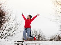 Woman wearing sportswear exercising outside during winter stock photos