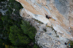 Outdoor sport. Rock climber ascending a challenging cliff. Extreme sport climbing. Stock Photo