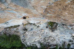 Outdoor sport. Rock climber ascending a challenging cliff. Extreme sport climbing. Royalty Free Stock Photos