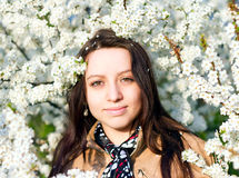 Outdoor spring portrait of young sensual pretty brunette Stock Image