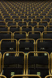 Outdoor stadium seats with yellow frames, straight on view Royalty Free Stock Photography
