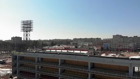 Outdoor stadium in spring. Open stadium in the spring, a tower with spotlights, aerial shooting from the copter stock video footage
