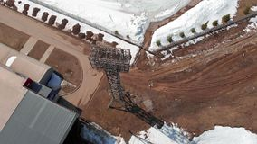 Outdoor stadium in spring. Open stadium in the spring, a tower with spotlights, aerial shooting from the copter stock footage