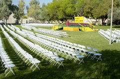 Outdoor Stage 1. Folding chairs and stage set up for an outdoor college graduation ceremony Royalty Free Stock Photos