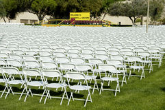 Outdoor Stage 2. Folding chairs and stage set up for an outdoor college graduation ceremony Stock Photo