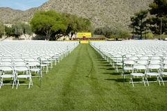 Outdoor Stage 3. Folding chairs and stage set up for an outdoor college graduation ceremony Stock Photos