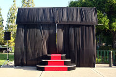 Outdoor stage and black curtains Stock Photos