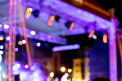 Outdoor stage with blue lighting. rock concert blurred lights. Stock Image