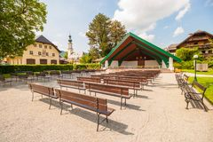 Outdoor stage with rows of wooden benches in the town of St.Gilgen, Austria royalty free stock photo