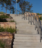 Outdoor stairway steps against blue sky. Outdoor stairway in parkland with handrails stock photo
