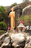 Outdoor Standing golden Buddha at Khao Takiab temple,Hua Hin Beach. Stock Images