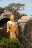 Outdoor Standing golden Buddha at Khao Takiab temple,Hua Hin Beach. Royalty Free Stock Photo