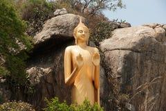 Outdoor Standing golden Buddha at Khao Takiab temple, Hua Hin Beach. Stock Photo