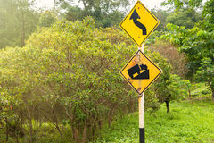 Outdoor steep hill sign and sharp curve on the way between hill. In Thailand royalty free stock photo