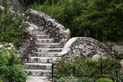 Outdoor Stone staircase among the trees Royalty Free Stock Photos