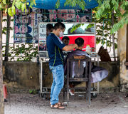 Outdoor Street Barber Shop in Vietnam Royalty Free Stock Images