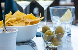 Outdoor street cafe table with finger food and local wine. Enjoying life stock photography