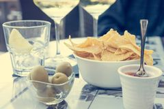 Outdoor street cafe table with finger food and local wine. Enjoying life royalty free stock images