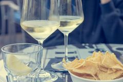 Outdoor street cafe table with finger food and local wine. Enjoying life stock photo