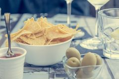 Outdoor street cafe table with finger food and local wine. Enjoying life royalty free stock photography