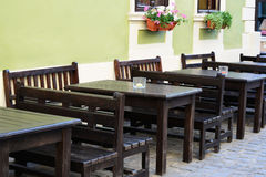 Outdoor street cafe tables and benches Royalty Free Stock Photo