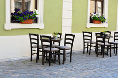 Outdoor street cafe tables and chairs Stock Photos