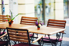 Outdoor street cafe tables ready for service. Stock Photos
