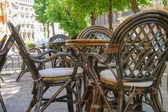 Outdoor street cafe with wooden furniture Royalty Free Stock Images