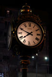 Outdoor street clock in Bucharest, Romania. Royalty Free Stock Images
