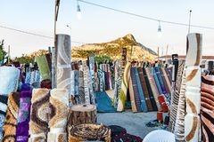 Outdoor street selling of carpets and rugs during Greek feast GREECE royalty free stock image