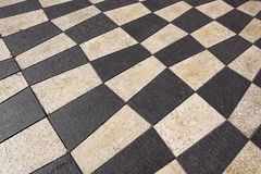 Outdoor street tiles with geometric pattern.The texture of perspective colored checkered tile in the street. Stock Photos