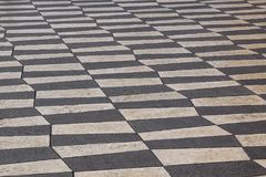 Outdoor street tiles with geometric pattern.The texture of perspective colored checkered tile in the street. Stock Photography