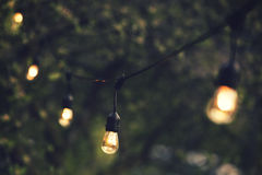 outdoor string lights hanging on a line Royalty Free Stock Photos