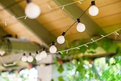 Outdoor string lights hanging on Royalty Free Stock Images