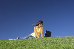 Outdoor study. Woman in outdoor study with a laptop Royalty Free Stock Image