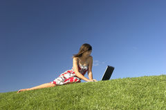 Outdoor study. Woman in outdoor study with a laptop Royalty Free Stock Photo