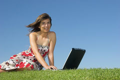 Outdoor study. Woman in outdoor study with a laptop Royalty Free Stock Images