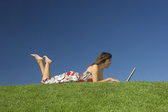 Outdoor study. Woman in outdoor study with a laptop Stock Photo