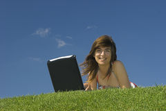 Outdoor study. Woman in outdoor study with a laptop Stock Images