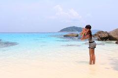 Outdoor summer of Asian young pretty woman shouting to the ocean at tropical beach Stock Image