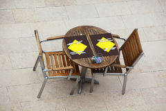 Outdoor summer cafe tables with chairs Royalty Free Stock Image
