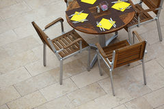 Outdoor summer cafe tables with chairs Royalty Free Stock Images