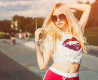 Outdoor summer fashion stylish portrait of young pretty blonde girl posing in vinage sunglasses Stock Photos