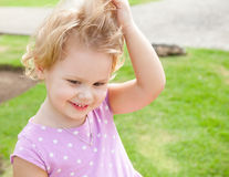 Outdoor summer portrait of cute playful girl Royalty Free Stock Photo
