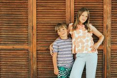Outdoor summer portrait of two funny kids royalty free stock photos