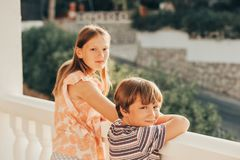 Outdoor summer portrait of two funny kids stock photography