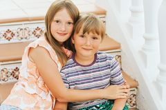 Outdoor summer portrait of two funny kids stock images